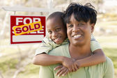Mother and Child In Front of Sold Real Estate Sign — Stock Photo