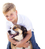 Handsome Young Boy Playing with His Dog Isolated — Stock Photo