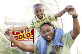 Father and Son In Front of Real Estate Sign — Stock Photo