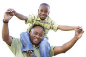 African American Son Rides Dad's Shoulders Isolated — Stock Photo