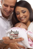 Mixed Race Family with Small Model House — Stock Photo