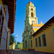 Narrow street and church in Trinidad, Cuba — Stock Photo #10236228