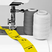 Sewing machine, mesuring tape and reels — Stock Photo