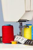 Sewing machine, measuring tape and thread bobbins — Stock Photo