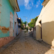 Narrow cobbled street in the colonial town of Trinidad in Cuba — Stock Photo #10254201