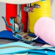 Sewing machine, reels with thread and zippers - Stock Photo
