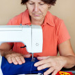 Hispanic woman working on a sewing machine — Stock Photo