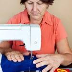 Hispanic woman working on a sewing machine — Stock Photo
