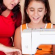 Mother and daughter sewing together — Stock Photo #10425176