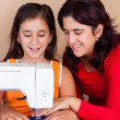 Mother and daughter sewing together — Stock Photo #10425244
