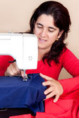 Woman working on a sewing machine — Stock Photo