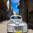 Classic Plymouth parked on Old Havana - Stock Photo