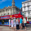 Tourists boarding a sightseeing bus in Havana - Stock Photo