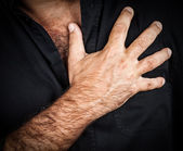 Close up of a hand grabbing a chest — Stock Photo