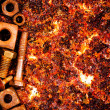 Nuts and bolts on a rusty background — Stock Photo