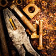 Stock Photo: Macro of tools on a rusty background