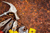 Tools on a rusty background — Stock Photo