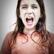 Very angry small hispanic girl yelling — Stock Photo