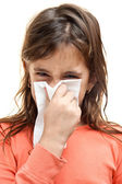 Girl sneezing on a paper tissue isolated on white — Stock Photo