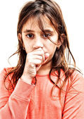 Hispanic girl suffering from the flu isolated on white — Stock Photo