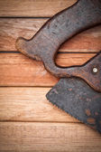 Handsaw over wooden boards — Stock Photo