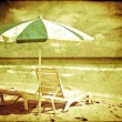 Vintage beach postcard with chairs and umbrellas — Stock Photo