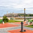 Royalty-Free Stock Photo: Park in Havana with the iconic El Morro castle in the background
