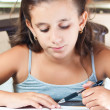 Beautiful hispanic girl working on her school project at home — Stock Photo