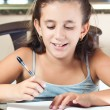 Beautiful hispanic girl working on her school project at home — Stock Photo #8481405