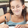 Beautiful hispanic girl working on her school project at home — ストック写真 #8481425
