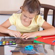 Beautiful hispanic girl working on her art project at home — Stock Photo