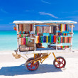 Cart selling typical souvenirs on the famous cuban beach of Varadero — Stock Photo