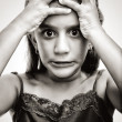 Black and white image of an angry and desperate girl - Stock Photo
