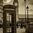 Vintage sepia image of the Big Ben in London with a typical red phone booth — Stockfoto