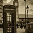 Vintage sepia image of the Big Ben in London with a typical red phone booth - Stock Photo