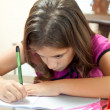 Small hispanic girl working on her homework — Stock Photo #8482018
