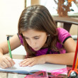 Small hispanic girl working on her homework — Stock Photo #8482021