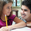 Young latin gather helping her daughter with homework — Stock Photo #8482029