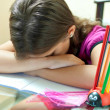 Tired girl sleeping after finishing her school homework — Stock Photo
