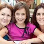 Three generations of latin women at home — Stock Photo