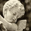 Beautiful old statue of a little infant angel — Photo