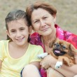 Latin family with a small pekingese dog — Stock Photo
