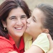 Stock Photo: Latin girl with her beautiful young mother