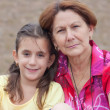 Latin girl with her grandmother in a park - Stock Photo