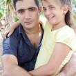 Hispanic father with her small daughter in a park — Stock Photo #8482437