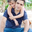 Hispanic father with her small daughter in a park — Stock Photo #8482448