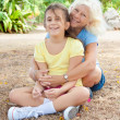 Latin girl with her grandmother in a park — Stock fotografie