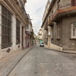 Street in Old Havana sidelined by old decaying buildings — Foto Stock
