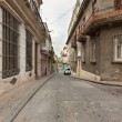 Stock Photo: Street in Old Havana sidelined by old decaying buildings