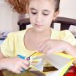 Beautiful latin girl working on her art project at home — 图库照片